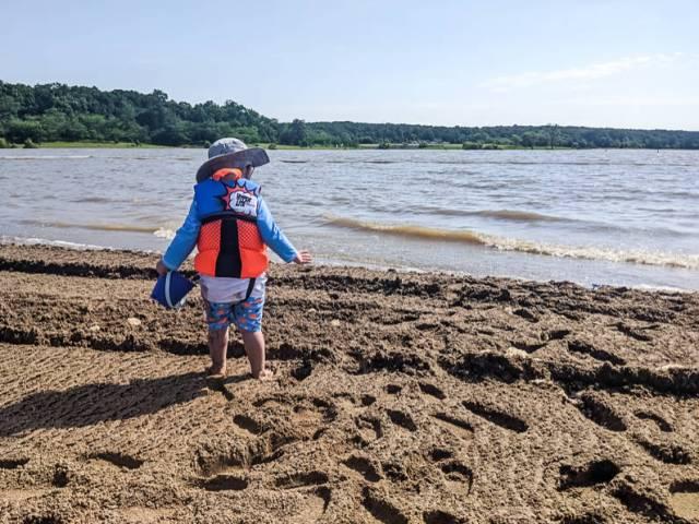 Playing on lake beach