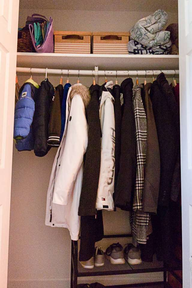 Coat closet before organizer closet system