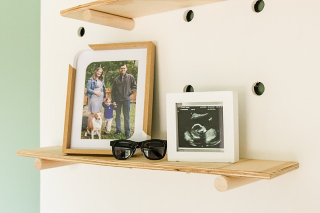 Giant pegboard wall shelf with frames, ultrasound photo