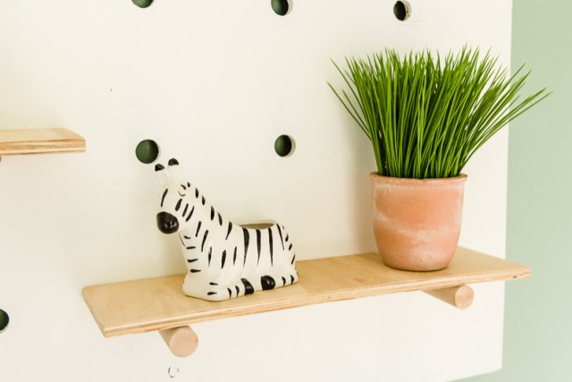 Giant pegboard wall shelf, grass plant, zebra vase