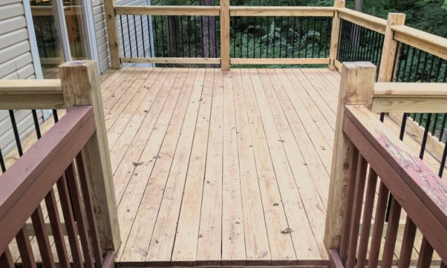 Ready for stain, sanded wood deck, refinishing
