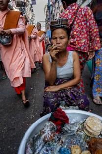 Cigar smoking woman in Yangon