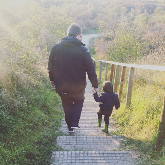 Walking with Daddy bear.