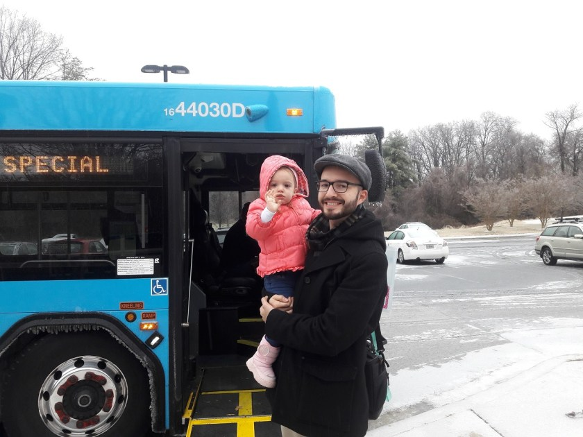 Photo of me and daughter in front of bus.