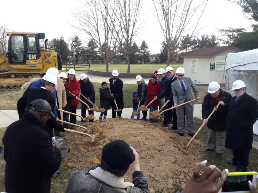 Photo of groundbreaking ceremony. County officials and staff turn dirt with shovels.