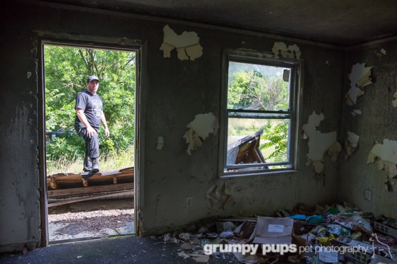 Detroit Dog Rescue, Dante Dasaro waits outside abandoned house in Detroit, grumpy pups pet photography