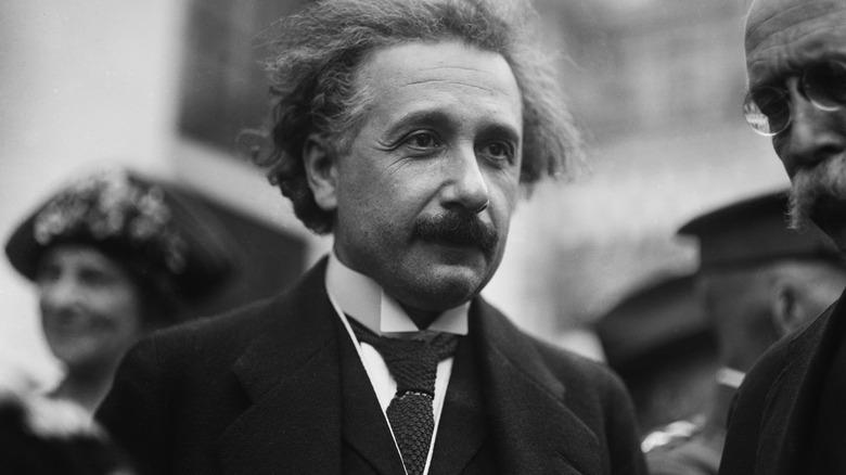 Albert Einstein standing in crowd
