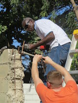 Putting roof on kitchen in Haiti
