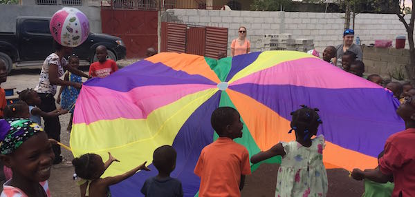 Kids play with parachute and ball