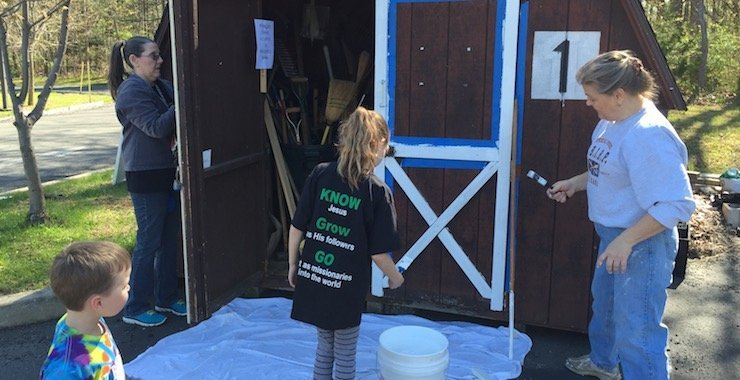 Painting an outdoor shed at Good Shepherd