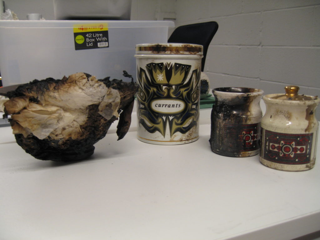 Fig.1 Selection of ceramics that were recovered from the fire. From left to right: Alexander Leckie pot, Robert Stewart kitchen storage jar; Robert Stewart spice jars