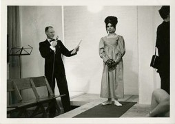 Photo of model with the compere from the 1964 Fashion show. Image from GSA's institutional photograph Archive. (Archive Reference GSAA/P/1/2431)