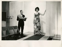 Photo of model with the compere from the 1964 Fashion Show. Image taken from GSA's institutional photograph archive. (Archive Reference GSAA/P/1/2432)