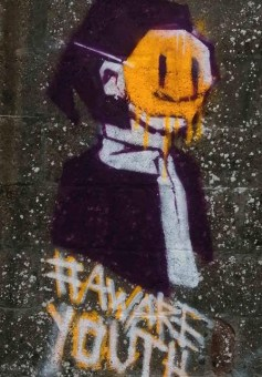 """Photograph of graffiti with the hashtag """"Aware Youth"""""""