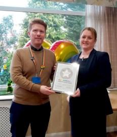 Switchboard's CEO presents Award to Emma Sherrif