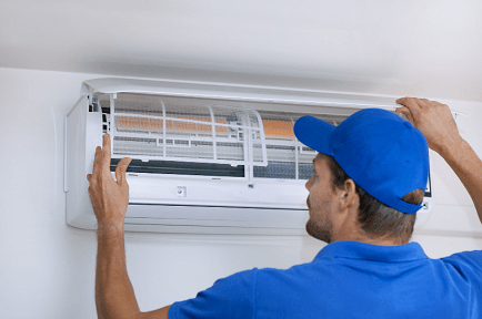 HVAC technician working on air conditioner