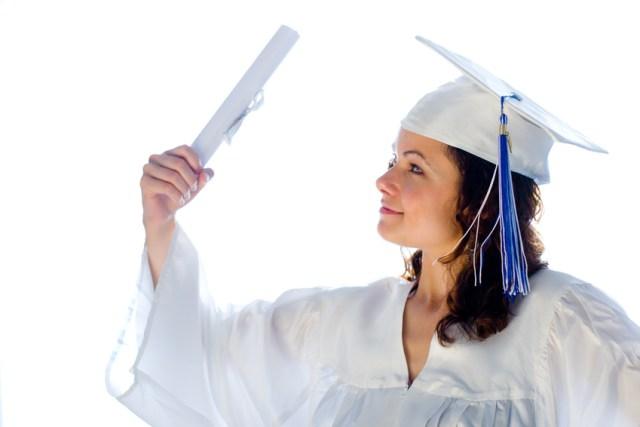 female graduate holding paper