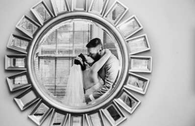 Wedding Couple Kissing in a mirror reflection, bride and groom black and white wedding photo at the Great Hall at Greenlake