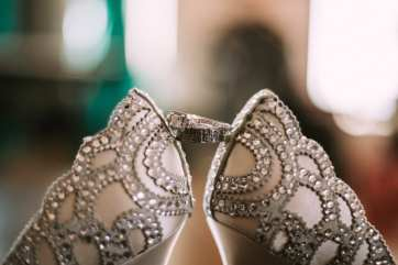 Badgley Mischka wedding shoes for the bride, silver with sparkly detailing with the bride and grooms wedding rings at Bell Harbor in Seattle.
