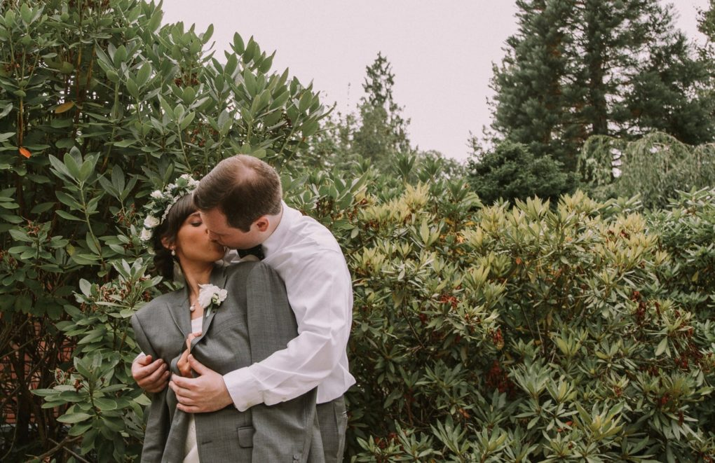 snohomish bride and groom kissing bride wearing a greenery and floral crown