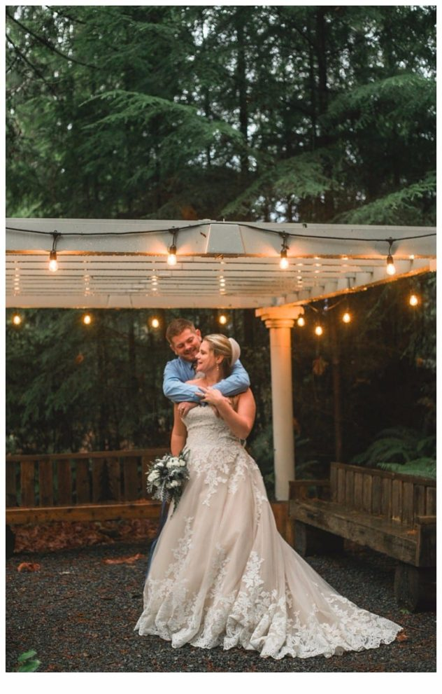 Winter Wedding at the Lookout Lodge in Snohomish bride and groom, bouquet, intimate, snuggle, arbor, lights, party lights, lace dress