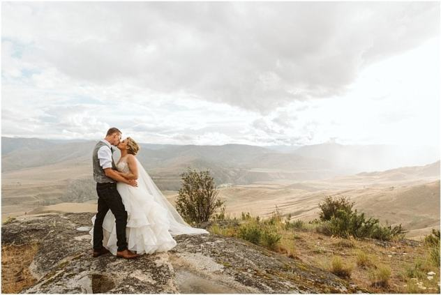 couple on a mountain top in methow washington after their small wedding