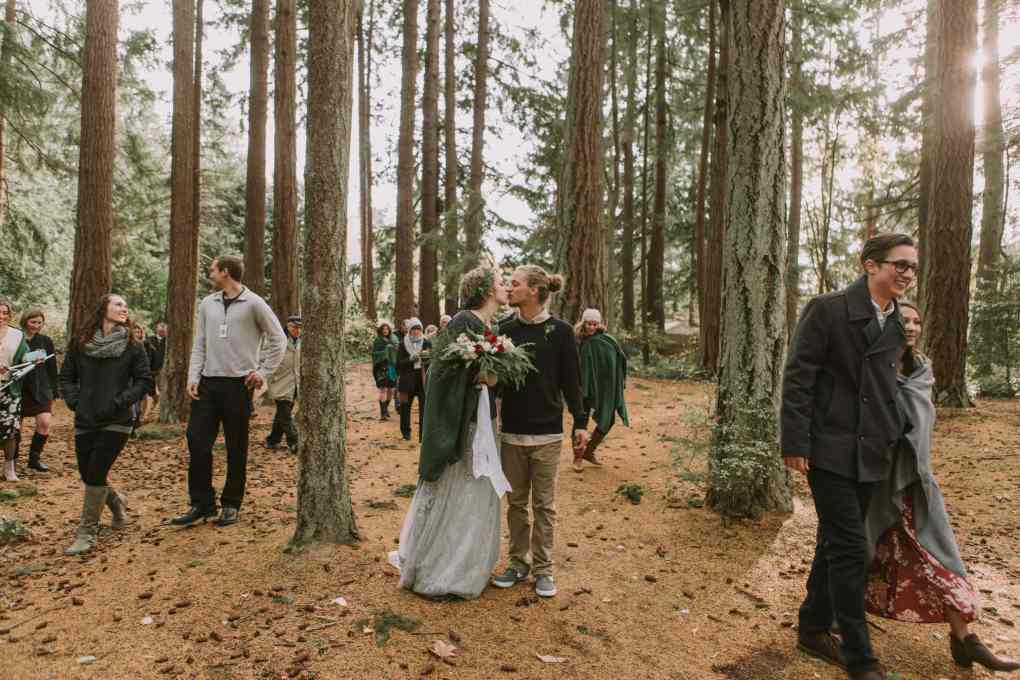 kitsap memorial park elopement washington state wedding photography couple kissing in the middle of the forest