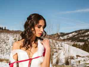 leavenworth wedding inspired by Belle of beauty and the beast bride in red winter cape at silvara winery vineyards