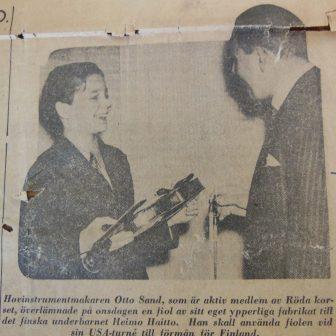Mr. Otto Sand presents the violin to Heimo, 1940.