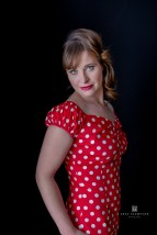 Brooke in red fitting dress from Two Lippy Ladies in Napier, Hawke's Bay.