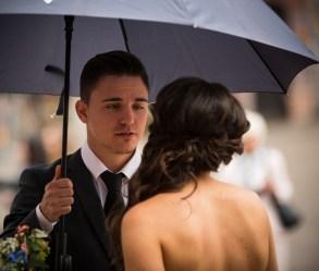 A young man looks adoringly at his girl.