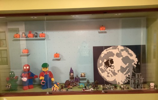 A set of Halloween-themed LEGO sets and creations in a display case at Mercy Hospital