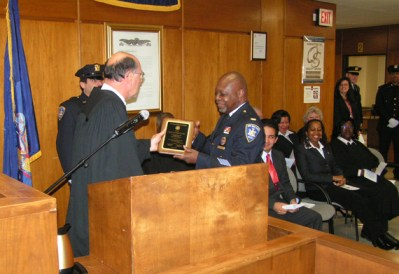Guardians President, Lt. Eugene Jordan receiving an award for his service to the  Nassau County Courts.