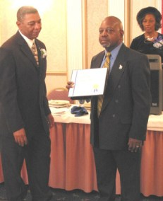 Pres. Eugene Jordan accepting the Certificate of Merit award for Capt. William Harry Thompson at the 47th Annual Federation of African American Civil Service Organizations, Inc. Awards Luncheon.