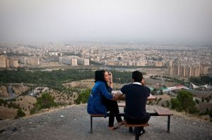 Samaneh and Shayan, a young pair rests on Kuhsar heights with a view over Tehran. Photo: Kaveh Rostamkhani