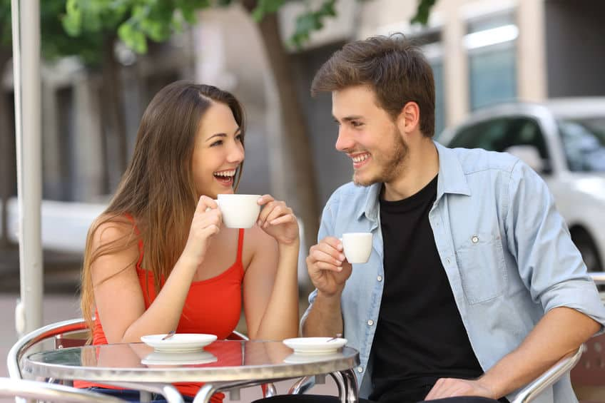 couple drinking coffee and talking happily