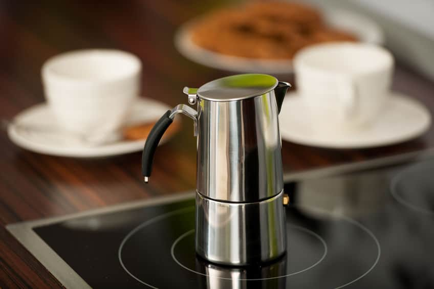 An example of an Italian coffee maker with a more modern design on top of an induction hob