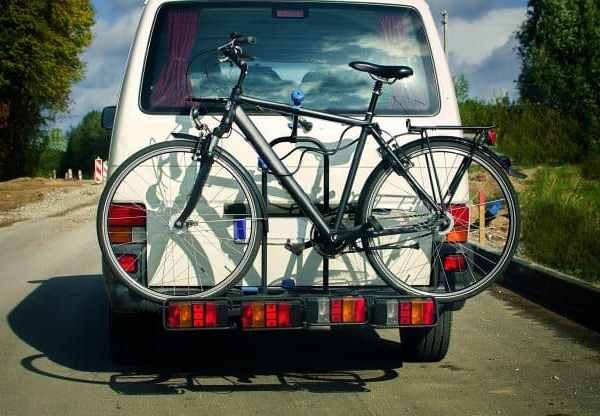 bicycles behind white car