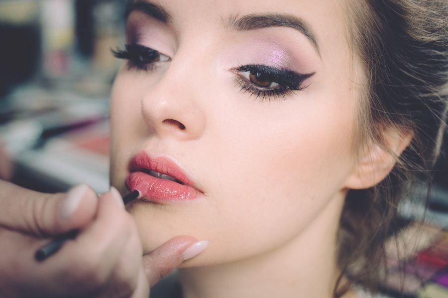 model applying some lip pencil