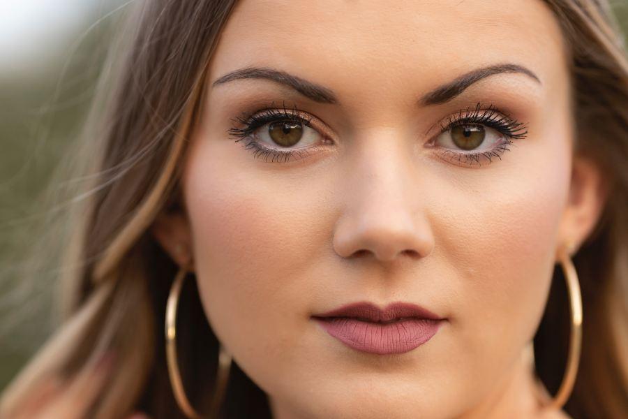eye brown girl modeling a lip pencil