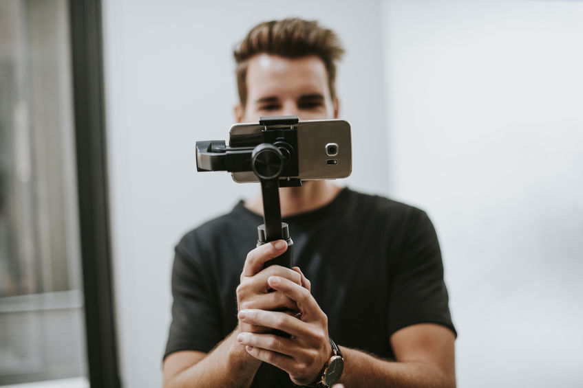 Man holding a gimbal with a phone