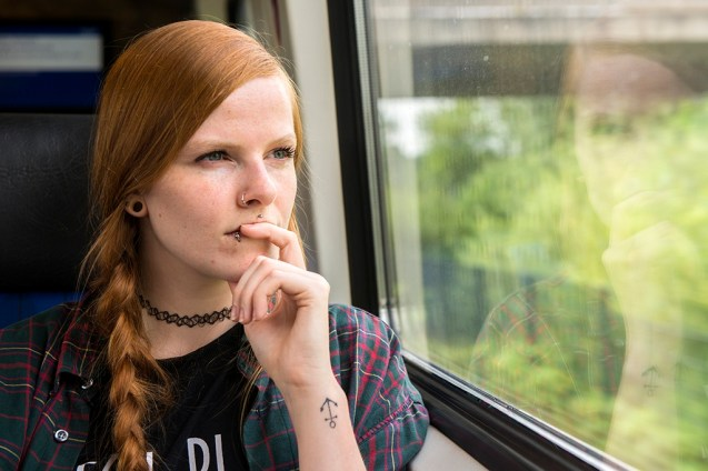 Red Haired Woman Commuting