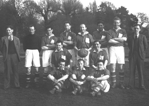 Nelco's football in the 1950s. Arthur Rose is holding the ball.