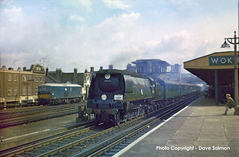 Steam train thunders through Woking in 1966, pictured by Dave Salmon..
