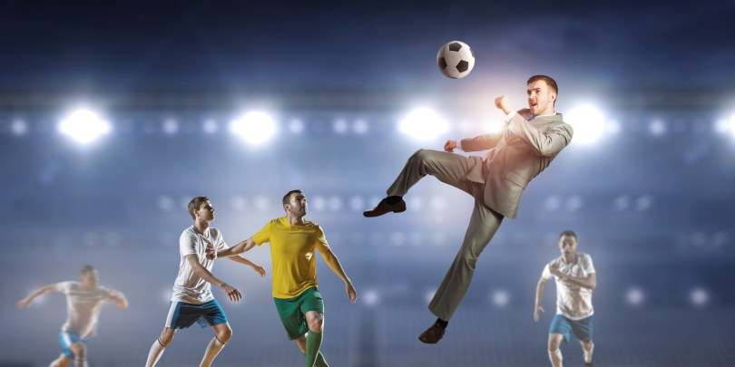 Businessman and players fighting for ball