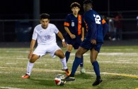 Hammond Golden Bear soccer forward Anthony Perez defends against Reservoir forward Kyree Akinkuowo while RHS midfielder Rudy Ventura watches during Reservoir's 2-1 win Friday at Hammond High School. Perez scored the only goal for the Golden Bears. Photo by YANAIR PHOTOGRAPHY.