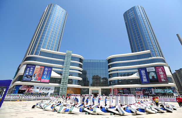Largest human mattress dominoes shopping centre China