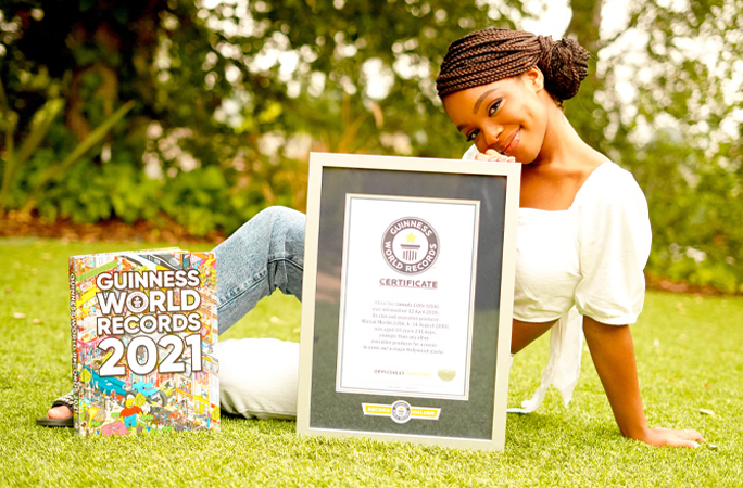 Marsai Martin youngest Hollywood executive producer smiling with Guinness World Records certificate and 2021book