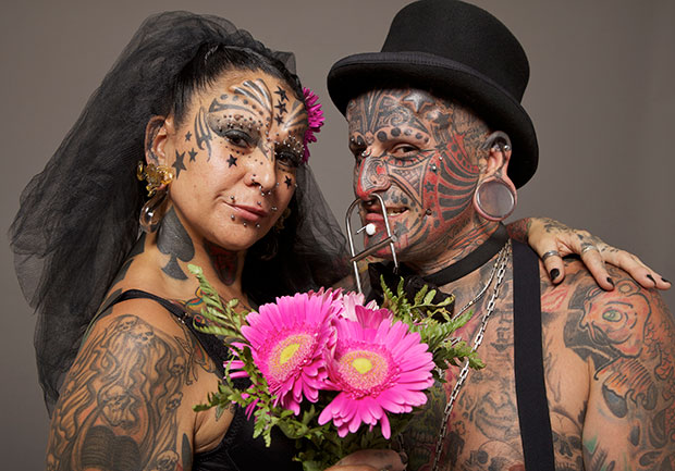 Most body modifications for a married couple