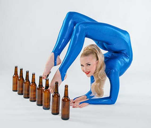 Most Bottles Opened With The Feet In One Minute Using The Contortionist Elbow Stand Position